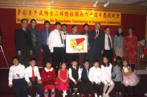 Dr. Herbert Yee (upper right, holding microphone) is joined on stage by students and other representatives of the local Confucius Chinese School. Photo by Lance Armstrong