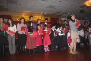 "Confucius Chinese School students and several adults sang, ""God Bless America,"" at the event. Photo by Lance Armstrong"