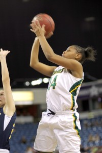 John F. Kennedy basketball star Lynette Johnson goes up for a shot in the 2012 Sac-Joaquin Championship Game against Oak Ridge. Kennedy won the game by a score of 62-58 and took home the section title. Photo courtesy of David Parsh