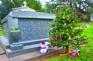 A Christmas tree accompanies the gravesite of some loved ones in this recent photograph taken at East Lawn Memorial Park. Photo by Lance Armstrong