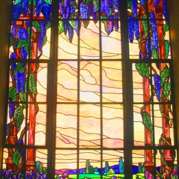 This stained glass piece, which is located at the east end of the mausoleum's East Corridor, is one of the building's largest art pieces. Photo by Lance Armstrong