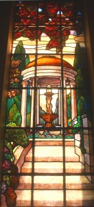 This large, colorful art glass window, which is located above a set of stairs, is one of the mausoleum's most notable art pieces. Photo by Lance Armstrong