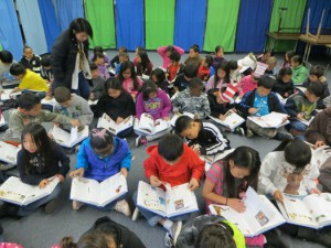 Third graders at Yav Pem Suab Academy enjoy reading the dictionaries donated to them by the Rotary Club of Pocket/Greenhaven on March 7, 2013. Photo courtesy Rotary Club of Pocket/Greenhaven.
