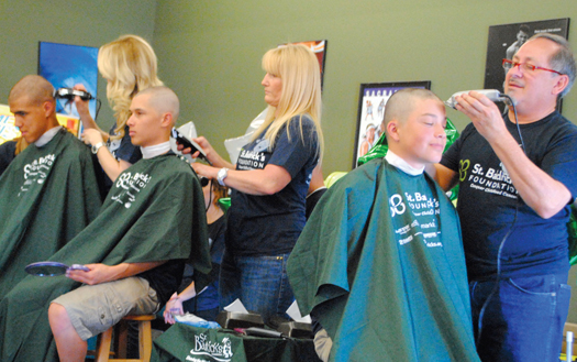 Thirty members of the C.K. McClatchy High School baseball team and 40 others, including members of the rugby team shaved their heads to help conquer kids' cancer on Sunday, March 10 at Giovanni's Pizza in Land Park. / Photos by Monica Stark