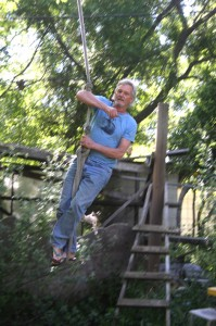 Hugh Gorman enjoys one of his favorite pastimes, swinging on a rope swing in his backyard. Photo by Lance Armstrong