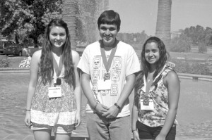 Left to right, Emily Moreno, Robert Fernandez and Rhianne Esparza of La Habra, Calif. pose together in front of the Red Lion Hotel – Woodlake Conference Center after competing in this year's National History Day state competition. Photo by Lance Armstrong