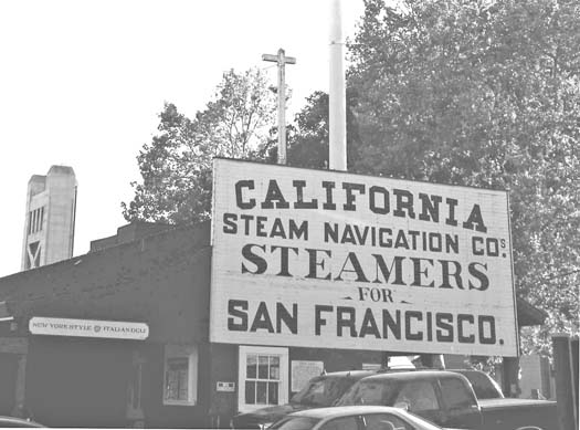 A large wooden sign on a structure on the west side of Front Street in Old Sacramento pays tribute to steamboats of the past. Photo by Lance Armstrong