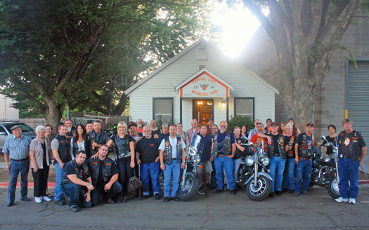 Members of the Capital City Motorcycle Club gather in front of their historic clubhouse. The club's first meeting in this