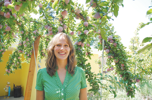 Amber Stott in her edible backyard in River Park, which will be the site of a dinner fundraiser for the Sacramento Food Literacy Center on Saturday, Aug. 31. Photo by Monica Stark