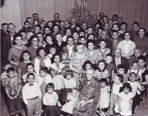 Mary Nevis (1878-1959), lower center, with a present in her hand, is shown in this 1957 photograph at the age of 80 with more than 80 members of her family. Mary was the wife of Manuel Nevis, Sr. Photo courtesy of PHCS