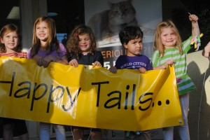 A group of about 20 young children ages 3 to 6 presented Happy Tails Pet Sanctuary with a check of $115 on Thursday, Oct. 17 after making money selling lemonade from a stand at East Portal Park for just one hour a few days beforehand. The children all attend a Virtues Class taught by Elmhurst resident Melody Fananapazir and as a part of the curriculum, they have to act on what they learn. After they handed over the check, they were quite eager to learn about and play with the cats at the shelter. Photo by Monica Stark