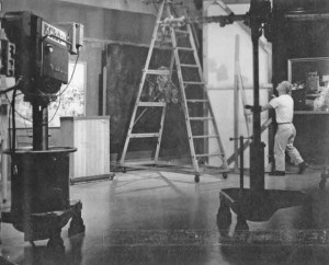 While working for KCRA-TV, Bob Miller adjusts a flat on the set of the Milly Sullivan Show in about 1955. Photo courtesy of Bob Miller