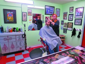 Rea MacSems cuts hair at Eddy's Deluxe, which is located in City Farms, next to Track 7 Brewery. Photo by Greg Brown