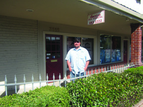 Phil White, a local fishing guide, stands in front of the store. Photo by Bill Laws