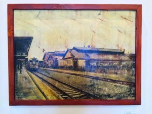 Andy Littlefield, Downtown Railyard, Multimedia monoprint on recycled wood, 36 inches by 28 inches