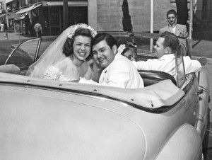 Tony and Anne Muljat sit in the back of a Buick convertible following their wedding at the Cathedral of the Blessed Sacrament. Photo courtesy of Tony and Anne Muljat
