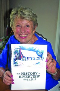 "Jackie (Leam) LaCornu holds a copy of the newly published book, ""The History of Riverview: 1926 to 2014, and Counting."" Photo by Lance Armstrong"