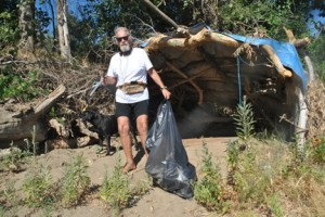 Gus Sand is shown cleaning up a camp near Chicory Bend beach. Photo by Monica Stark