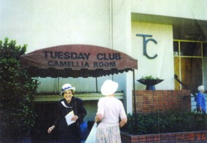 Tuesday Club of Sacramento members stand on the east side of the clubhouse in front of the Camellia Room awning in this 1996 photograph. Photo courtesy of the Tuesday Club of Sacramento