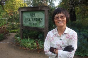 Daisy Mah stands in front of the WPA Rock Garden. The sign for the garden in the background was created by Sacramento artist Jim Ford. Photo by Lance Armstrong