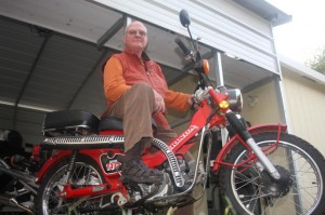 Ray Jenkins, who owned Cycle Tune Co. for more than 40 years, sits on his 1984 Honda Trail CT110. Photo by Lance Armstrong