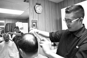 Pocket barber Brian Wong donates free haircuts to the homeless every Wednesday at Union Gospel Church. Here, he is shown with client Danny Regalado who is on the path to recovery from a life of drug and alcohol addiction. Photo by Monica Stark