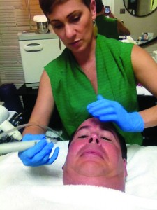East Sacramento resident Cindy Ann Mendes Ravn of Maverick's Style House working her magic with the HydraFacial MD treatment.  Don't underestimate the value of a great esthetician! /  Photo by Michael Saeltzer