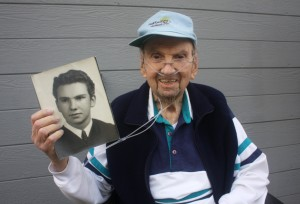 Jim McFall, who grew up in East Sacramento, holds a copy of his senior year portrait. He graduated from Sacramento High School in February 1942. Photo by Lance Armstrong