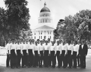 Photo courtesy of Sacramento Gay Men's Chorus Archives /  This historic photo of the Sacramento Gay Men's Chorus was taken circa 1985 in front of the state capitol with some of the group's founding members, including Frank Lasso-Lawler who is shown in the back row, the first on the left. Dennis Mangers is shown 14th from the left and David Kwong is 23rd from left (or fourth from right).The chorus is celebrating its 30 year anniversary with a concert on May 8 at Sacramento Memorial Auditorium at 8 p.m.