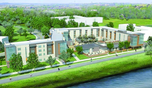 This rendering shows the new residence hall how it is expected to appear following its construction along the American River. This student housing facility is scheduled to be completed in the fall of 2017. / Photo courtesy of Sacramento State University