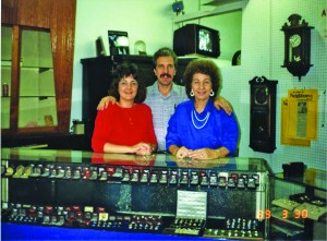 Left to right, Vivian, Chuck and Mary Sathre stand inside Sathre Jewelers in this 1989 photograph. / Photo courtesy of the Sathre family