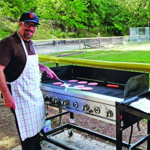 Over the Fence columnist, Greg Brown, is also a chef at the little league snack shack. Nice hat.