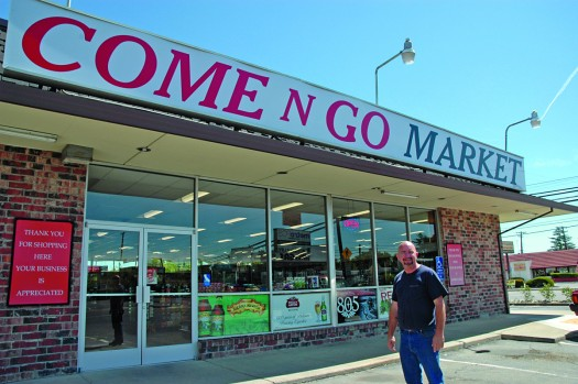 New owner Pat Mulhall standing proud in front of the new and improved Come-n-Go Market in Land Park. / Photo by Greg Brown