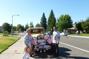 "Shown here is Dolores Silva Greenslate, the grand marshal of this year's Spirit of the Pocket Parade with driver David Chin and his convertible. David, a master wood carver, designed the duck display as a tribute to Greenslate, who was known as the ""Duck Lady"" when she saved ducks during the construction of the Greenhaven 70 housing development. / Photo courtesy of David Chin"