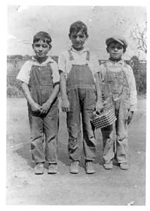 Ed Mauricio (left) stands next to his brother, Herman (center), and his neighborhood friend, Marvin Silva, on the old Riverside Road in about 1929. / Photo courtesy of PHCS
