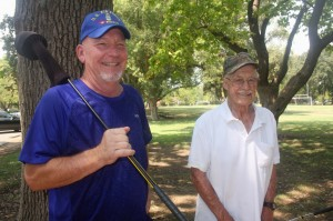 Golfers Bob Suber, Jr. and Jim Hayes enjoy a moment together after playing nine holes of golf at the William Land Golf Course./ Photo by Lance Armstrong