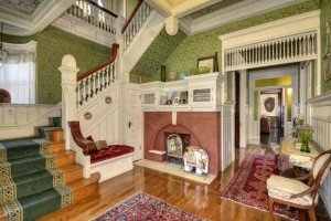The old Mason/Smith mansion includes hardwood floors, a decorative staircase, three fireplaces, including the one shown above, and many other features. \ Photo courtesy of RE/MAX Gold