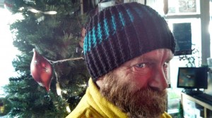 Photo courtesy Mark walked from his homeless encampment to meet writer Dean for a coffee. He is shown here wearing a beanie Dean made for him.